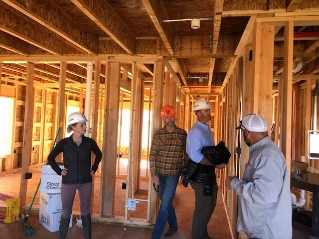 Oct 2020 Photo of Gunnison County Commissioners inside Paintbrush Housing Development